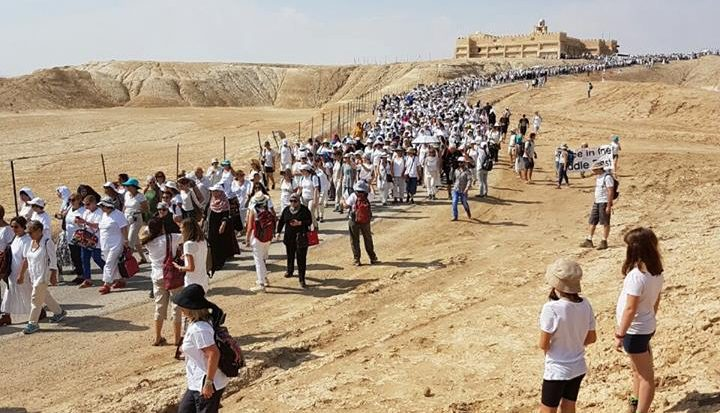 Women marching at qasr-el-yahud-