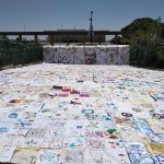 Peace quilt spread in front of the Knesset